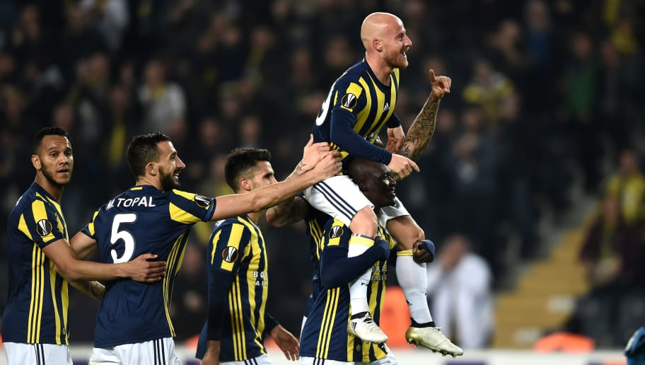 Fenerbahce's Slovakian midfielder Miroslav Stoch (R) celebrates with teammates  after scoring a goal  during the UEFA Europa League Group A football match between Fenerbahce SK and FC Zorya Luhansk at the Fenerbahce Ulker stadium, on November 24, 2016, in Istanbul. / AFP / OZAN KOSE        (Photo credit should read OZAN KOSE/AFP/Getty Images)