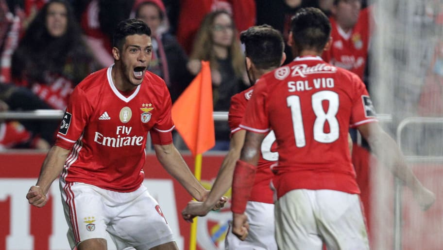 Benfica's Mexican forward Raul Jimenez (L) celebrates his goal with teammates during the Portuguese league football match SL Benfica vs Sporting CP at the Luz stadium in Lisbon on December 11, 2016. / AFP / JOSE MANUEL RIBEIRO        (Photo credit should read JOSE MANUEL RIBEIRO/AFP/Getty Images)