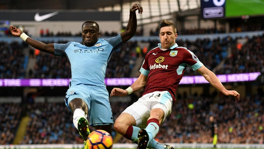 MANCHESTER, ENGLAND - JANUARY 02:  Bacary Sagna of Manchester City (L) and Stephen Ward of Burnley (R) battle for possession during the Premier League match between Manchester City and Burnley at Etihad Stadium on January 2, 2017 in Manchester, England.  (Photo by Shaun Botterill/Getty Images)