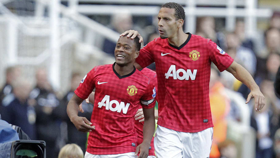 """Manchester United's French defender Patrice Evra (L) celebrates with English defender Rio Ferdinand after scoring their second goal during the English Premier League football match between Newcastle United and Manchester United at Sports Direct Arena in Newcastle, north-east England on October 7, 2012. AFP PHOTO/GRAHAM STUART  RESTRICTED TO EDITORIAL USE. No use with unauthorized audio, video, data, fixture lists, club/league logos or """"live"""" services. Online in-match use limited to 45 images, no video emulation. No use in betting, games or single club/league/player publications        (Photo credit should read GRAHAM STUART/AFP/GettyImages)"""