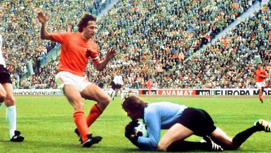 West German goalkeeper Sepp Maier catches the ball in front of Dutch forward Johan Cruyff as defender Franz Beckenbauer (L) looks on, 07 July 1974 in Munich, during the World Cup soccer final. Host West Germany beat The Netherlands 2-1 to earn its second World Cup title, twenty years after its first win over Hungary (3-2), 04 July 1954 in Bern.  AFP PHOTO / AFP / STAFF AND -        (Photo credit should read STAFF/AFP/Getty Images)