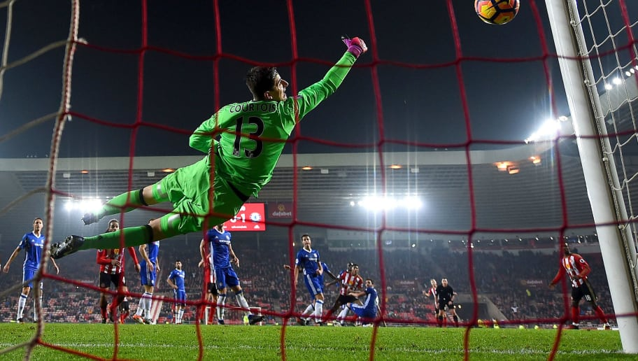 SUNDERLAND, ENGLAND - DECEMBER 14:  Thibaut Courtois of Chelsea saves a shot by Patrick van Aanholt of Sunderland during the Premier League match between Sunderland and Chelsea at Stadium of Light on December 14, 2016 in Sunderland, England.  (Photo by Laurence Griffiths/Getty Images)