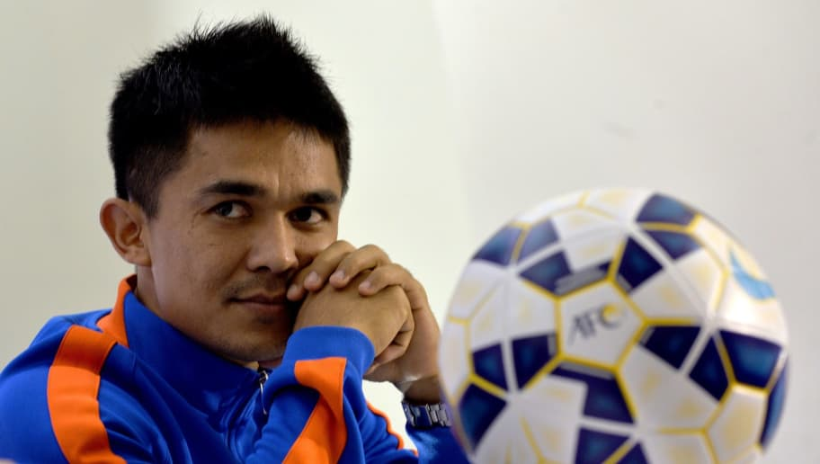 Indian footballer Sunil Chhetri gestures during a press conference by the Indian football team in Bangalore on November 11, 2015. India play Guam in the FIFA World Cup soccer qualifying match on November 12.   AFP PHOTO/Manjunath KIRAN        (Photo credit should read Manjunath Kiran/AFP/Getty Images)