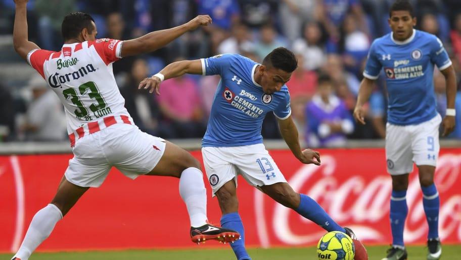 Cruz Azul s forward Angel Mena (C) vies for the ball with Necaxa s defender  Mario 80b3e7f8ef025