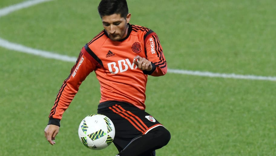 River Plate defender Leonel Vangioni controls the ball during a training session at the Club World Cup football tournament in Kawasaki on December 18, 2015. AFP PHOTO / TOSHIFUMI KITAMURA / AFP / TOSHIFUMI KITAMURA        (Photo credit should read TOSHIFUMI KITAMURA/AFP/Getty Images)