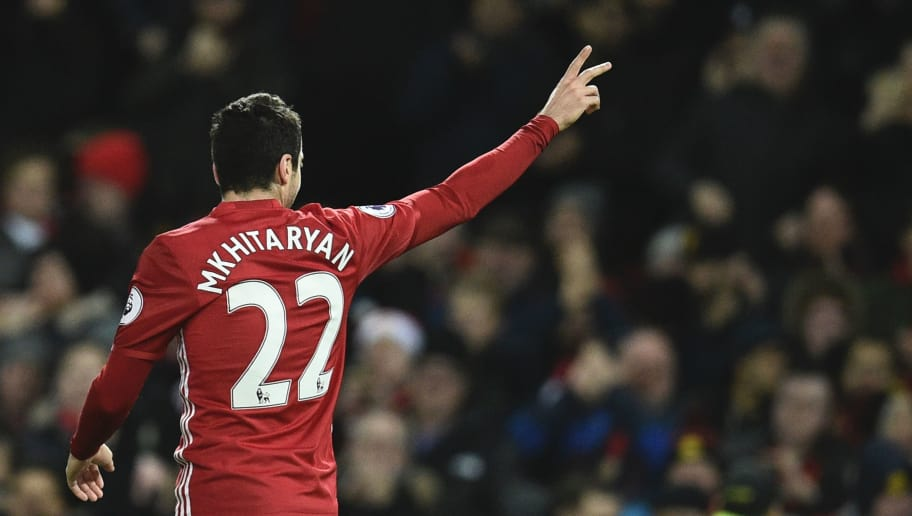 Manchester United's Armenian midfielder Henrikh Mkhitaryan celebrates scoring their third goal during the English Premier League football match between Manchester United and Sunderland at Old Trafford in Manchester, north west England, on December 26, 2016. / AFP / Oli SCARFF / RESTRICTED TO EDITORIAL USE. No use with unauthorized audio, video, data, fixture lists, club/league logos or 'live' services. Online in-match use limited to 75 images, no video emulation. No use in betting, games or single club/league/player publications.  /         (Photo credit should read OLI SCARFF/AFP/Getty Images)