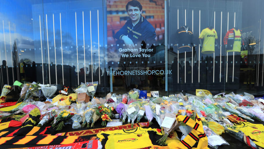 WATFORD, ENGLAND - JANUARY 14:  Watford fans leave tributes to Graham Taylor outisde the stadium prior the Premier League match between Watford and Middlesbrough at Vicarage Road on January 14, 2017 in Watford, England.  (Photo by Richard Heathcote/Getty Images)