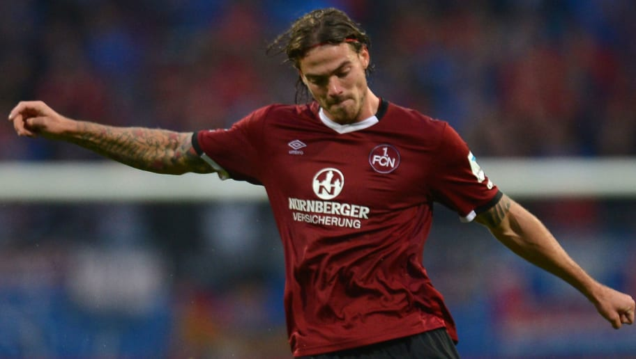 NUREMBERG, GERMANY - AUGUST 12: Dave Bulthuis of Nuernberg plays the ball during the Second Bundesliga match between 1. FC Nuernberg and 1. FC Heidenheim 1846 at Arena Nuernberg on August 12, 2016 in Nuremberg, Germany.  (Photo by Micha Will/Bongarts/Getty Images)