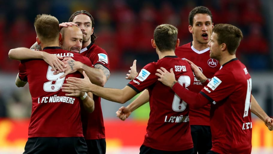 DUESSELDORF, GERMANY - DECEMBER 09:  (L-R) Guido Burgstaller of Nuernberg celebrates the first goal with Miso Brecko and Dave Bulthuis during the Second Bundesliga match between Fortuna Duesseldorf and 1. FC Nuernberg at Esprit-Arena on December 9, 2016 in Duesseldorf, Germany.  (Photo by Christof Koepsel/Bongarts/Getty Images)