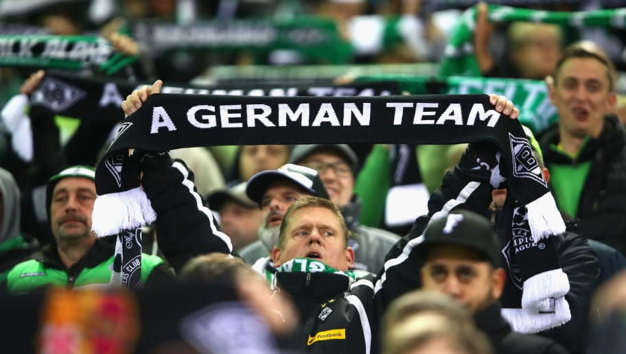 MOENCHENGLADBACH, GERMANY - NOVEMBER 01:  A Borussia Moenchengladbach fan holds up a scarf reading 'A German team' prior to kick off during the UEFA Champions League Group C match between VfL Borussia Moenchengladbach and Celtic at Borussia-Park on November 1, 2016 in Moenchengladbach, Germany. A sign outside a Scottish bar went viral before the club's 2-0 Champions League win over Celtic, after the author seemingly gave up attempting to spell 'Moenchengladbach' - instead opting for 'A German Team'. (Photo by Alex Grimm/Bongarts/Getty Images)