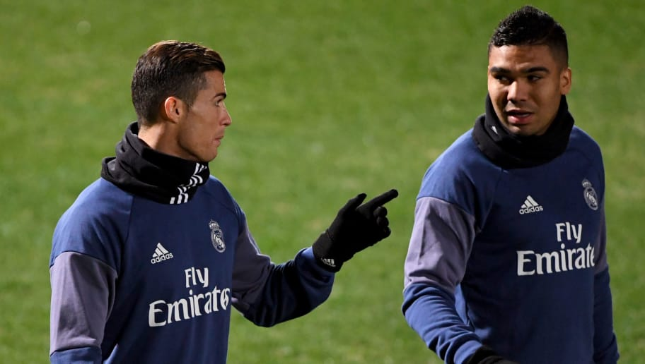bed3a87ce Real Madrid s forward Cristiano Ronaldo (L) chats with midfielder Casemiro  (R) during