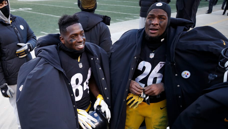 PITTSBURGH, PA - JANUARY 08:  Antonio Brown #84 and Le'Veon Bell #26 of the Pittsburgh Steelers are seen on the sidelines during the fourth quarter against the Miami Dolphins in the AFC Wild Card game at Heinz Field on January 8, 2017 in Pittsburgh, Pennsylvania.  (Photo by Gregory Shamus/Getty Images)