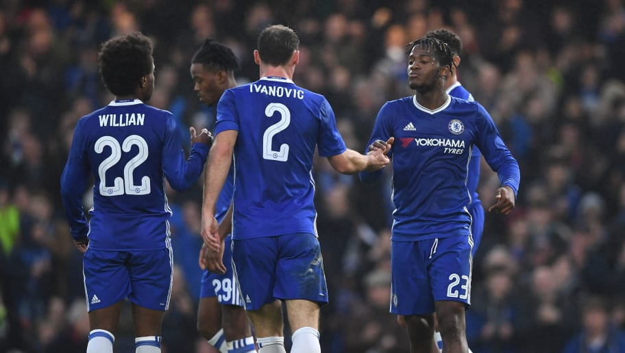 LONDON, ENGLAND - JANUARY 08: Michy Batshuayi of Chelsea (R) celebrates scoring his sides second goal with Branislav Ivanovic of Chelsea (C), Willian of Chelsea (L) during The Emirates FA Cup Third Round match between Chelsea and Peterborough United at Stamford Bridge on January 8, 2017 in London, England.  (Photo by Shaun Botterill/Getty Images)