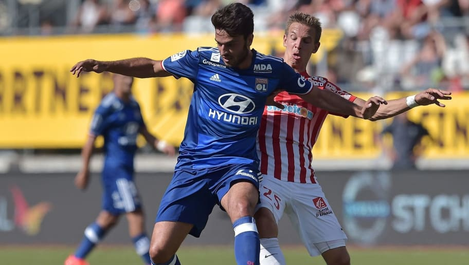 Lyon's French midfielder Clement Grenier (L) vies with Nancy's French midfielder Benoit Pedretti during the French L1 football match Nancy (ASNL) versus Lyon (OL) on August 14, 2016 at the Marcel Picot Stadium, in Tomblaine, eastern France. / AFP / PATRICK HERTZOG        (Photo credit should read PATRICK HERTZOG/AFP/Getty Images)