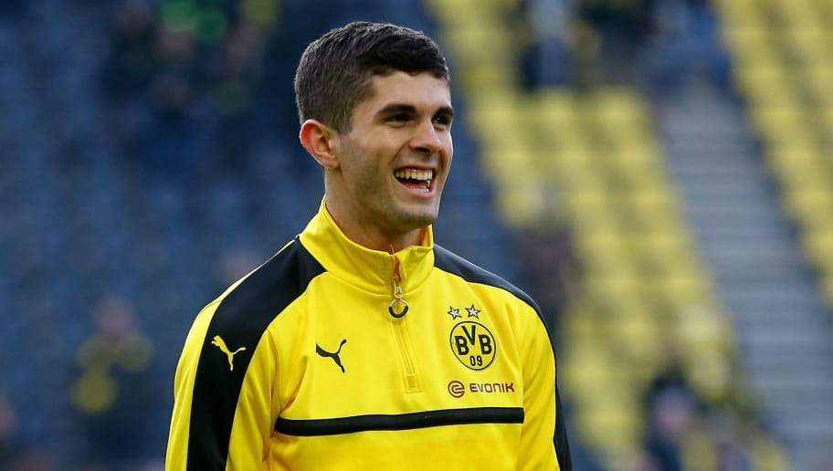 DORTMUND, GERMANY - DECEMBER 03:  Christian Pulisic of Dortmund smiles prior to the Bundesliga match between Borussia Dortmund and Borussia Moenchengladbach at Signal Iduna Park on December 3, 2016 in Dortmund, Germany.  (Photo by Christof Koepsel/Bongarts/Getty Images)