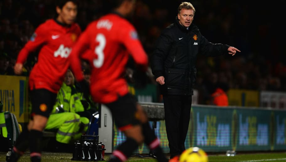 NORWICH, ENGLAND - DECEMBER 28:  David Moyes manager of Manchester United signals as he watches Shinji Kagawa (L) and Patrice Evra of Manchester United (C) in action during the Barclays Premier League match between Norwich City and  Manchester United at Carrow Road on December 28, 2013 in Norwich, England.  (Photo by Michael Regan/Getty Images)