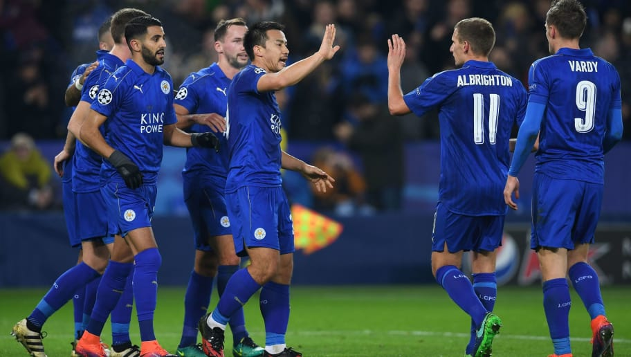 Leicester City's Algerian midfielder Riyad Mahrez (3L) celebrates scoring his team's second goal from the penalty spot with Leicester City's Japanese striker Shinji Okazaki (C) and Leicester City's English midfielder Marc Albrighton (2R) and Leicester City's English striker Jamie Vardy (R) during the UEFA Champions League group G football match between Leicester City and Club Brugge at the King Power Stadium in Leicester, central England on November 22, 2016. / AFP / Paul ELLIS        (Photo credit should read PAUL ELLIS/AFP/Getty Images)