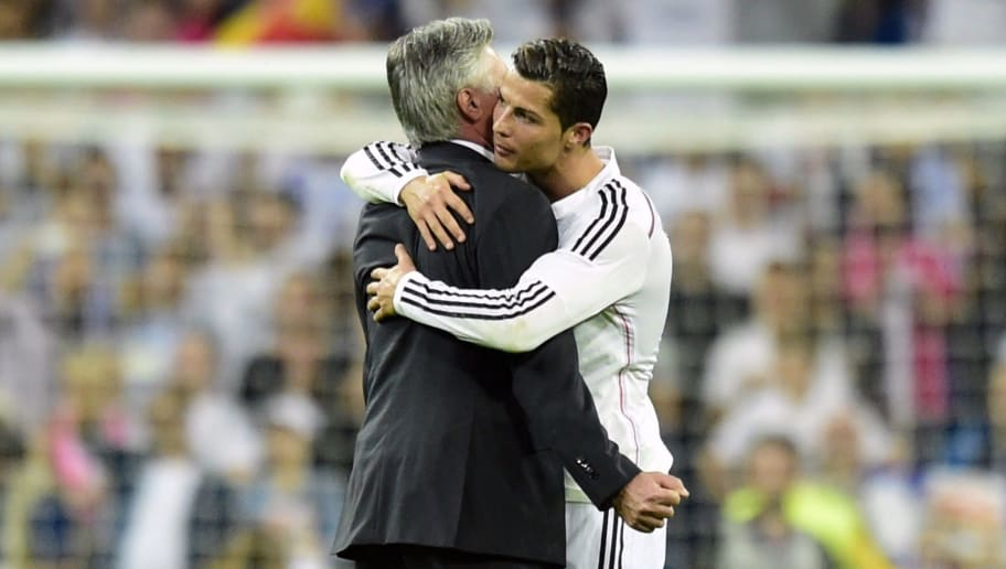 Real Madrid's Italian coach Carlo Ancelotti (L) embraced to Real Madrid's Portuguese forward Cristiano Ronaldo after beating to Barcelona during the Spanish league football match Real Madrid CF vs FC Barcelona at the Santiago Bernabeu stadium in Madrid on October 25, 2014.   AFP PHOTO/ JAVIER SORIANO        (Photo credit should read JAVIER SORIANO/AFP/Getty Images)