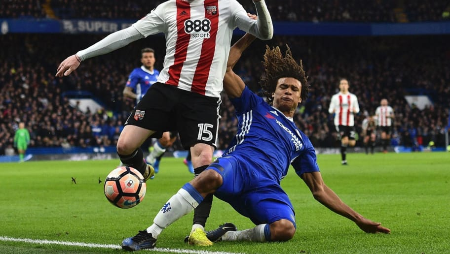 Chelsea's Dutch defender Nathan Ake (R) tackles Brentford's English midfielder Ryan Woods (L) during the English FA Cup fourth round football match between Chelsea and Brentford at Stamford Bridge in London on January 28, 2017. / AFP / Glyn KIRK / RESTRICTED TO EDITORIAL USE. No use with unauthorized audio, video, data, fixture lists, club/league logos or 'live' services. Online in-match use limited to 75 images, no video emulation. No use in betting, games or single club/league/player publications.  /         (Photo credit should read GLYN KIRK/AFP/Getty Images)