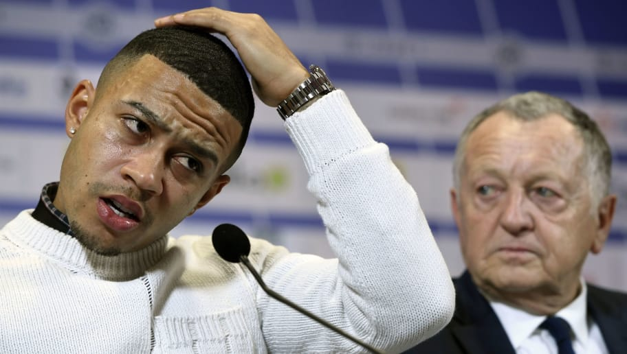 Lyon's football club new Dutch forward Memphis Depay (L) speaks next to Lyon's French president Jean-Michel Aulas (R) during a press conference on January 20, 2017 at the Parc Olympique Lyonnais in Lyon, eastern France.  / AFP / PHILIPPE DESMAZES        (Photo credit should read PHILIPPE DESMAZES/AFP/Getty Images)