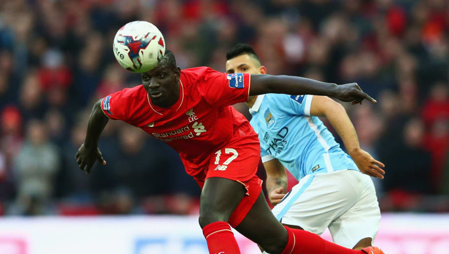 LONDON, ENGLAND - FEBRUARY 28:  Mamadou Sakho of Liverpool clears the ball from Sergio Aguero of Manchester City during the Capital One Cup Final match between Liverpool and Manchester City at Wembley Stadium on February 28, 2016 in London, England.  (Photo by Michael Steele/Getty Images)