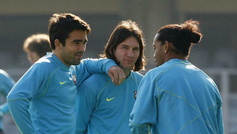 Barcelona's Ronaldinho (R) talks with Portuguese Deco (L) and Argentinian Lionel Messi during his first team training session in Barcelona, 29 January 2008. Ronaldinho has not played in 2008 owing to tendonitis in the knee and Barca have suffered over the six matches he has been away, with Real Madrid moving seven points clear in La Liga.   AFP PHOTO/LLUIS GENE (Photo credit should read LLUIS GENE/AFP/Getty Images)