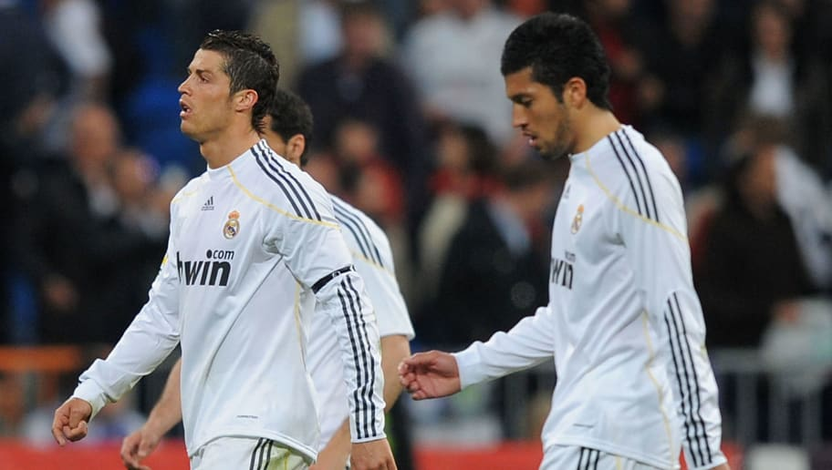 MADRID, SPAIN - APRIL 10:  Cristiano Ronaldo (L) and Ezequiel Garay of Real Madrid leave the pitch after Real lost 2-0 to Barcelona in the La Liga match between Real Madrid and Barcelona at the Estadio Santiago Bernabeu on April 10, 2010 in Madrid, Spain.  (Photo by Denis Doyle/Getty Images)