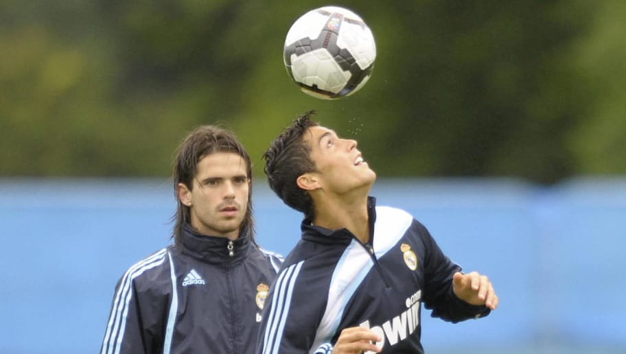 Real Madrid's Argentinian player Fernando Gago (L) watches his Portuguese team-mate Cristiano Ronaldo during their training session on July 21, 2009 at the Carton House Hotel, in Maynooth, 22 km from Dublin. AFP PHOTO/MIGUEL RIOPA (Photo credit should read MIGUEL RIOPA/AFP/Getty Images)