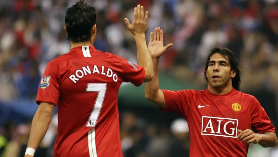 Manchester United's Cristiano Ronaldo (L) celebrates with teammate Carlos Tevez after scoring the second goal against al-Hilal during their football match at King Fahd Stadium in Riyadh, 21 January 2008. Hilal won the match 3-2. AFP PHOTO/HASSAN AMMAR (Photo credit should read HASSAN AMMAR/AFP/Getty Images)