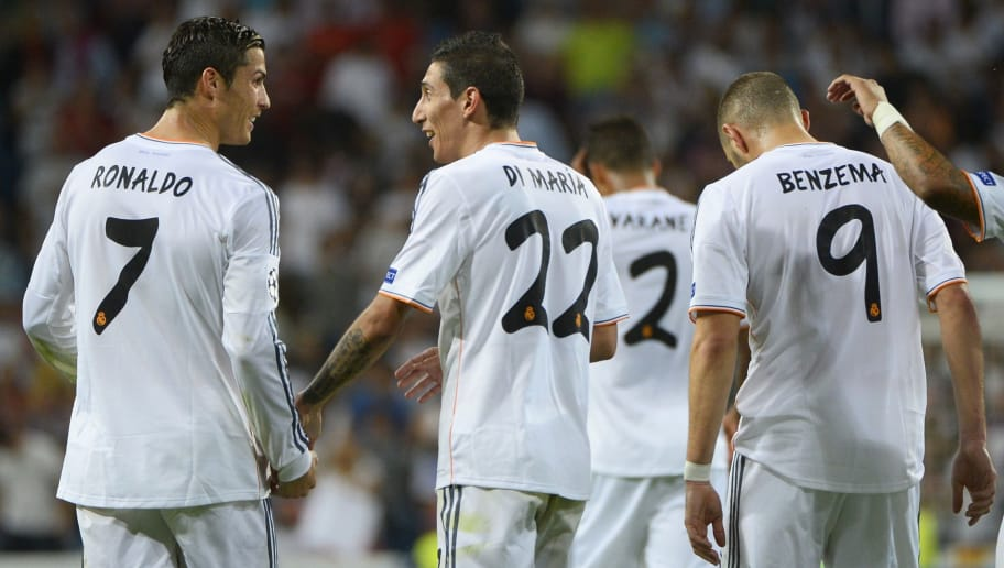 Real Madrid's Portuguese forward Cristiano Ronaldo (L), Real Madrid's French forward Karim Benzema (R) and Real Madrid's Argentinian midfielder Angel di Maria (C) celebrate after scoring during the UEFA Champions League Group B football match Real Madrid CF vs FC Copenhagen on October 2, 2013 at the Santiago Bernabeu stadium in Madrid.   AFP PHOTO / PIERRE-PHILIPPE MARCOU        (Photo credit should read PIERRE-PHILIPPE MARCOU/AFP/Getty Images)