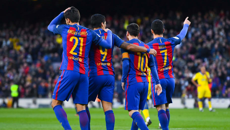 BARCELONA, SPAIN - JANUARY 14:  Ardan Turan (R) of FC Barcelona celebrates with his team mates (L-R) Andre Gomes, Luis Suarez and Lionel Messi after scoring his team's fourth goalduring the La Liga match between FC Barcelona and UD Las Palmas at Camp Nou stadium on January 14, 2017 in Barcelona, Spain.  (Photo by David Ramos/Getty Images)