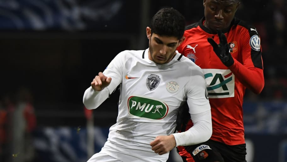 Paris Saint-Germain's Portuguese striker Goncalo Guedes (L) vies with Rennes' French striker James Edward Lea Siliki  during the French cup football match Rennes vs PSG on February 1, 2017 at Roahzon Park stadium in Rennes, western France.  / AFP / DAMIEN MEYER        (Photo credit should read DAMIEN MEYER/AFP/Getty Images)