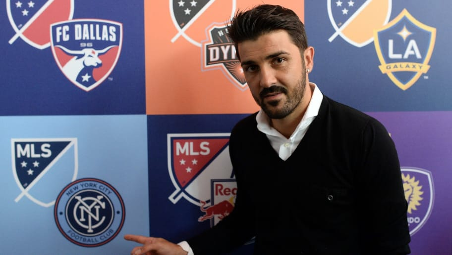New York City Football Club (NYCFC) player David Villa poses during an event to unveil Major League Soccer (MLS) new logo, in New York on September 18, 2014. MLS unveiled the new logo ahead of its 20th season. AFP PHOTO/Jewel Samad        (Photo credit should read JEWEL SAMAD/AFP/Getty Images)
