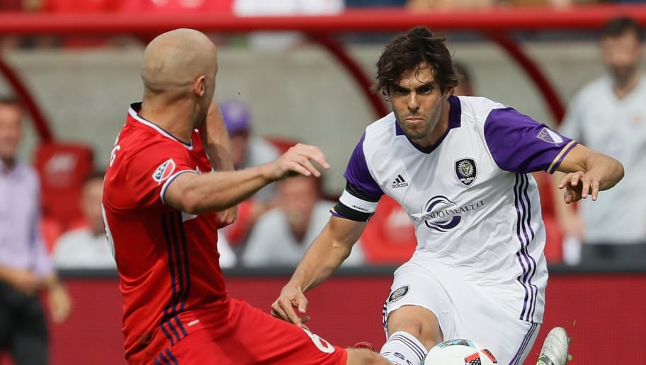 BRIDGEVIEW, IL - AUGUST 14: Kaka #10 of Orlando City FC fires a shot past Eric Gehrig #6 of Chicago Fire during an MLS match at Toyota Park on August 14, 2016 in Bridgeview, Illinois. The Fire and Orlando City SC tied 2-2. (Photo by Jonathan Daniel/Getty Images)