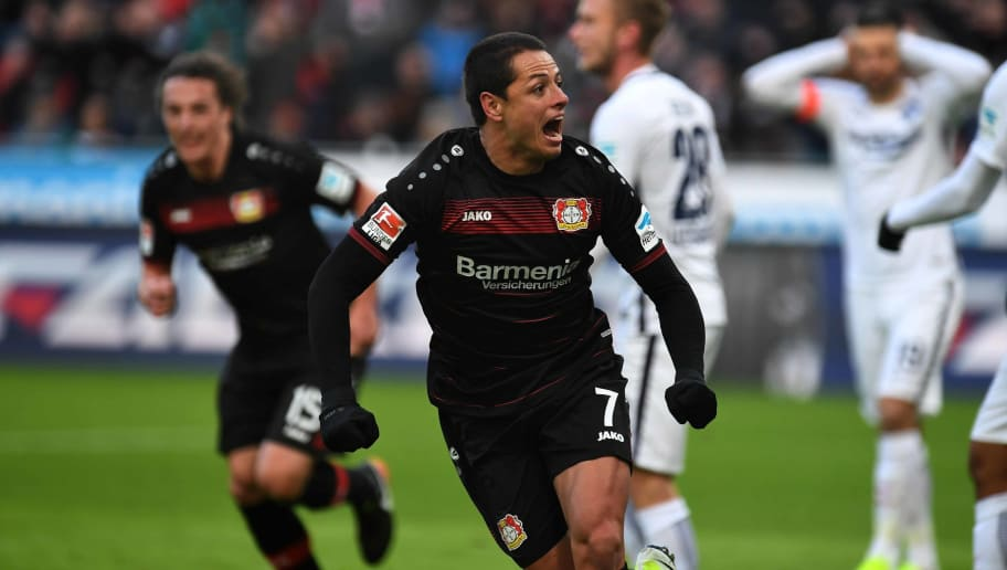 Leverkusen's Mexican striker Javier 'Chicharito' Hernandez celebrates during the German first division Bundesliga football match of Bayer Leverkusen vs Hertha BSC Berlin in Leverkusen, western Germany, on January 22, 2017. / AFP / PATRIK STOLLARZ / RESTRICTIONS: DURING MATCH TIME: DFL RULES TO LIMIT THE ONLINE USAGE TO 15 PICTURES PER MATCH AND FORBID IMAGE SEQUENCES TO SIMULATE VIDEO. == RESTRICTED TO EDITORIAL USE == FOR FURTHER QUERIES PLEASE CONTACT DFL DIRECTLY AT + 49 69 650050         (Photo credit should read PATRIK STOLLARZ/AFP/Getty Images)