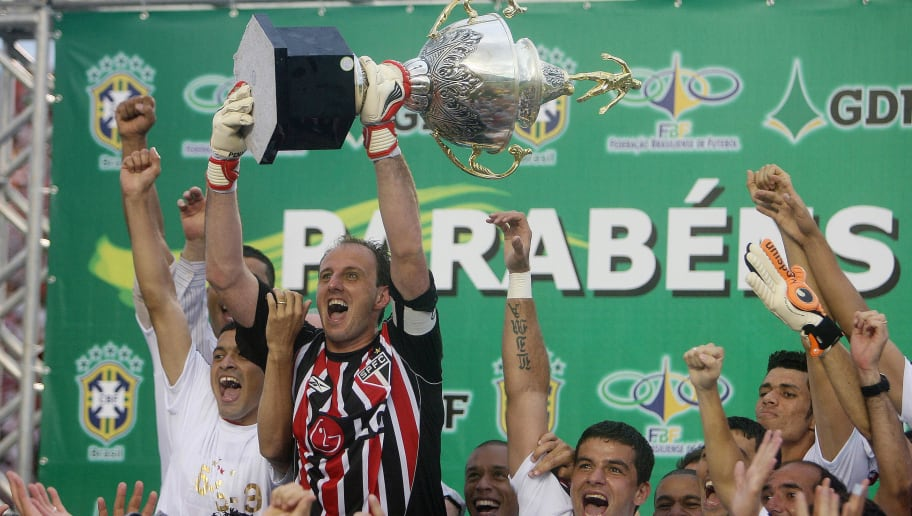 Brazilian Sao Paulo's goalkeeper and team captain Rogerio Ceni (2nd L) raises the Brazilian Championship trophy on December 7, 2008 at the Bizerrao stadium in Brasilia, Brazil. Sao Paulo defeated Goias 1-0 and won the tournament.  AFP PHOTO / Joedson Alves (Photo credit should read JOEDSON ALVES/AFP/Getty Images)