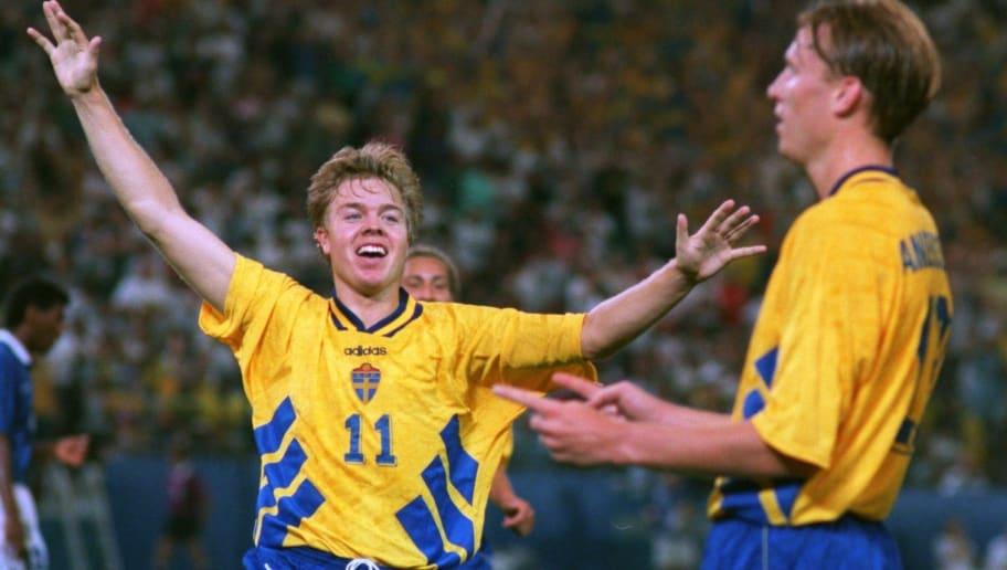 28 JUN 1994:  THOMAS BROLIN OF SWEDEN, LEFT, RUNS TO CONGRATULATE TEAMMATE KENNET ANDERSSON AFTER ANDERSSON SCORED TO PUT SWEDEN UP 1-0 AGAINST BRAZIL IN THEIR 1994 WORLD CUP MATCH  AT THE SILVERDOME IN PONTIAC, MICHIGAN.  THE GAME ENDED IN A DRAW, 1-1.
