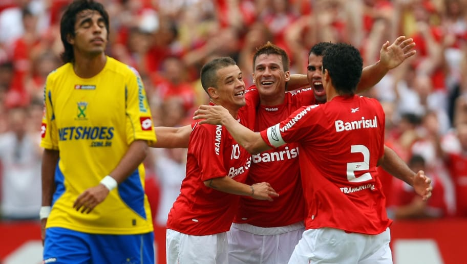 Internacional player Indio (C) celebrates with teammates after scoring against Santo Andre during their Brazilian Championship last date match at Beira Rio stadium on December 6, 2009 in Porto Alegre, Brazil. AFP PHOTO/Jefferson Bernardes (Photo credit should read JEFFERSON BERNARDES/AFP/Getty Images)