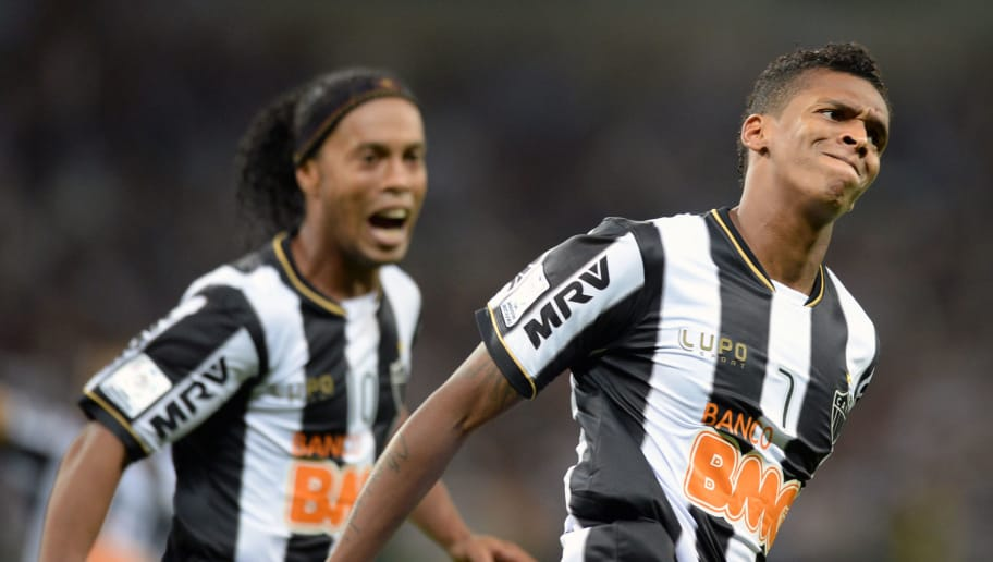 Brazilian Atletico Mineiro's Jo (R) celebrates with teammate Ronaldinho his goal against Paraguayan Olimpia during their Libertadores Cup second leg football match at the Mineirao stadium in Belo Horizonte, Brazil on July 24, 2013. AFP PHOTO / VANDERLEI ALMEIDA        (Photo credit should read VANDERLEI ALMEIDA/AFP/Getty Images)