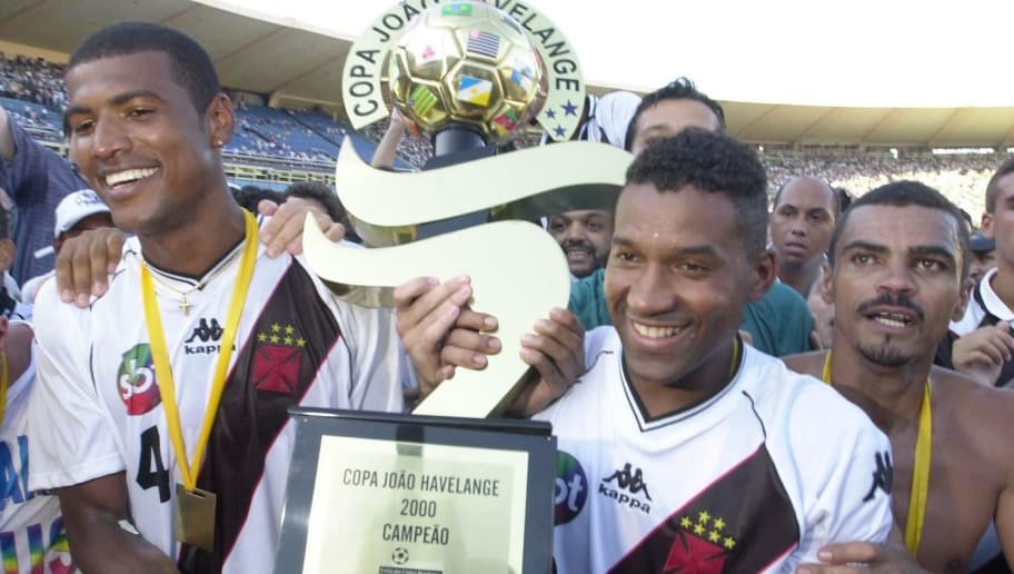 18 Jan 2001: Junior Baiano (left) and Viola of Vasco De Gama hold up the trophy after winning the Brazilian National Cup Final, the Jose Havelange Cup between Vasco De Gama and Sao Caetano played at the Maracan Stadium in Rio de Janeiro, Brazil. Mandatory Credit: Allsport UK/ALLSPORT