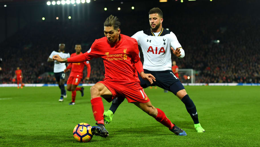 LIVERPOOL, ENGLAND - FEBRUARY 11: Roberto Firmino of Liverpool controls the ball under pressure of Kyle Walker of Tottenham Hotspur during the Premier League match between Liverpool and Tottenham Hotspur at Anfield on February 11, 2017 in Liverpool, England.  (Photo by Mike Hewitt/Getty Images for Tottenham Hotspur FC)