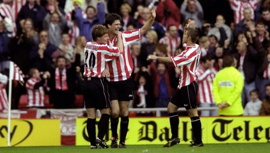 31 Oct 1999:  Niall Quinn of Sunderland celebrates his goal against Tottenham Hotspur with team mates Stefan Schwarz and Kevin Phillips during the FA Carling Premiership match at the Stadium of Light in Sunderland, England. Sunderland won 2-1. \ MandatoryCredit: Clive Brunskill /Allsport