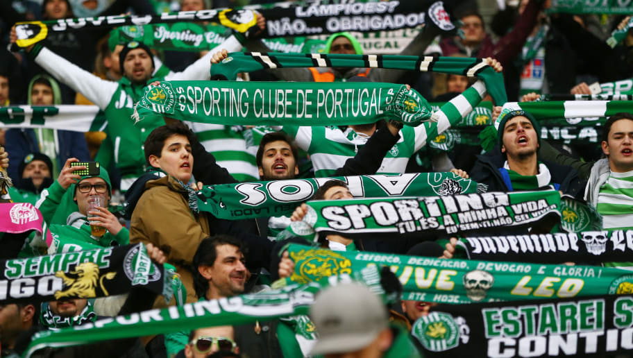 LEVERKUSEN, GERMANY - FEBRUARY 25:  Sporting Lisbon supporters cheer prior to the UEFA Europa League round of 32 second leg match between Bayer Leverkusen and Sporting Lisbon at BayArena on February 25, 2016 in Leverkusen, Germany.  (Photo by Alex Grimm/Bongarts/Getty Images)