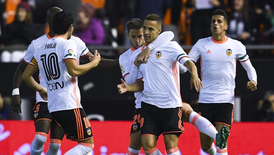 VALENCIA, SPAIN - DECEMBER 04:  Rodrigo Moreno (C) of Valencia CF celebrates after scoring his team's first goal during the La Liga match between Valencia CF and Malaga CF at Mestalla stadium on December 4, 2016 in Valencia, Spain.  (Photo by David Ramos/Getty Images)