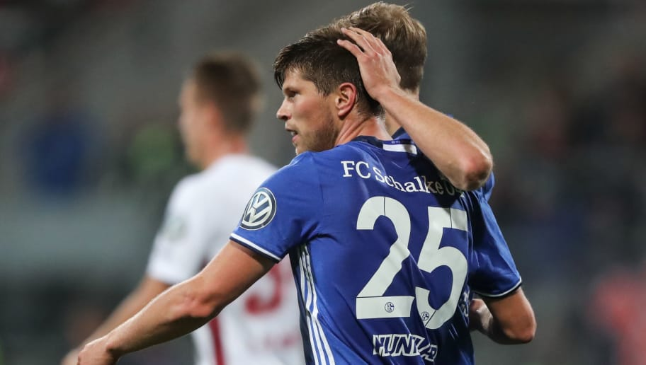 NUREMBERG, GERMANY - OCTOBER 26:  Klaas-Jan Huntelaar of Schalke (front) celebrates his team's second goal with his team mate Benedikt Hoewedes during the DFB Cup match between 1. FC Nuernberg and FC Schalke 04 at Stadion Nuernberg on October 26, 2016 in Nuremberg, Germany.  (Photo by Simon Hofmann/Bongarts/Getty Images)