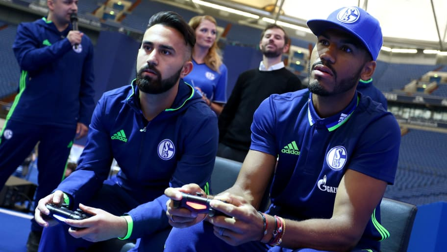 GELSENKIRCHEN, GERMANY - JUNE 26:  Eric Choupo-Moting (R) plays esport prior to the FC Schalke 04 general assembly at Veltins Arena on June 26, 2016 in Gelsenkirchen, Germany.  (Photo by Christof Koepsel/Bongarts/Getty Images)