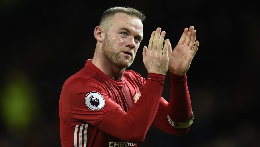 Manchester United's English striker Wayne Rooney applauds the fans following the English Premier League football match between Manchester United and Hull City at Old Trafford in Manchester, north west England, on February 1, 2017. The match ended in a draw at 0-0. / AFP / Oli SCARFF / RESTRICTED TO EDITORIAL USE. No use with unauthorized audio, video, data, fixture lists, club/league logos or 'live' services. Online in-match use limited to 75 images, no video emulation. No use in betting, games or single club/league/player publications.  /         (Photo credit should read OLI SCARFF/AFP/Getty Images)
