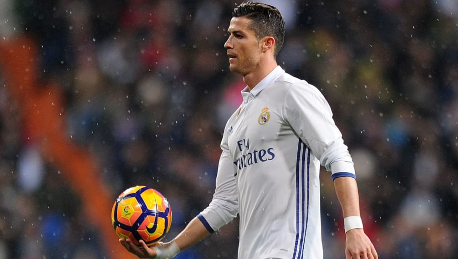 MADRID, SPAIN - JANUARY 29:  Cristiano Ronaldo of Real Madrid holds the matchball during the La Liga match between Real Madrid CF and Real Sociedad de Futbol at the Bernabeu on January 29, 2017 in Madrid, Spain.  (Photo by Denis Doyle/Getty Images)