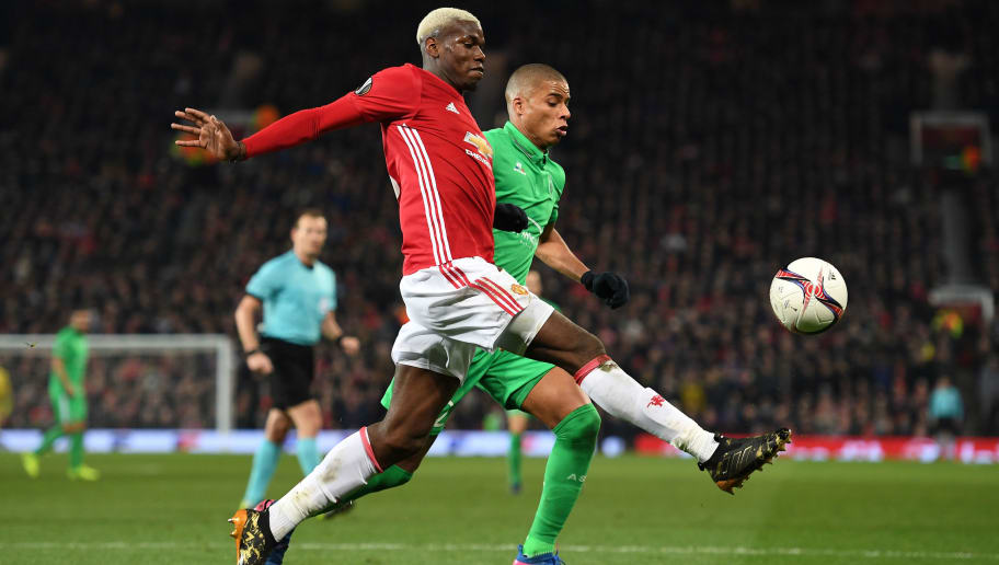 MANCHESTER, ENGLAND - FEBRUARY 16:  Paul Pogba of Manchester United and Kevin Monnet-Paquet of Saint-Etienne in action during the UEFA Europa  League Round of 32 first leg match between Manchester United and AS Saint-Etienne at Old Trafford on February 16, 2017 in Manchester, United Kingdom.  (Photo by Shaun Botterill/Getty Images)