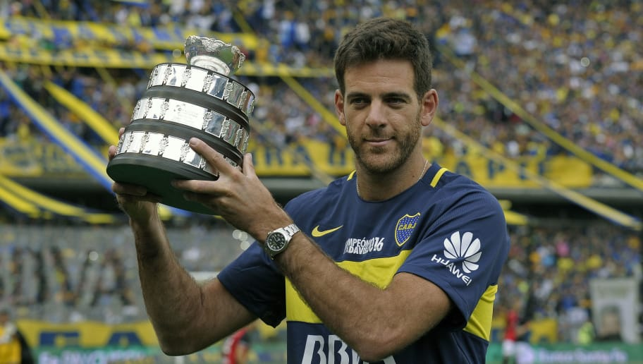 Argentinian tennis player Juan Martin del Potro holds a Davis Cup 2016 trophy  replica while poseing for the photographer before the Argentina's First Division football match between Boca Juniors and Colon  at La Bombonera stadium, in Buenos Aires, on December 18, 2016.  Argentina tennis team won the Davis Cup 2016 after defeating Crocacia. / AFP / ALEJANDRO PAGNI        (Photo credit should read ALEJANDRO PAGNI/AFP/Getty Images)